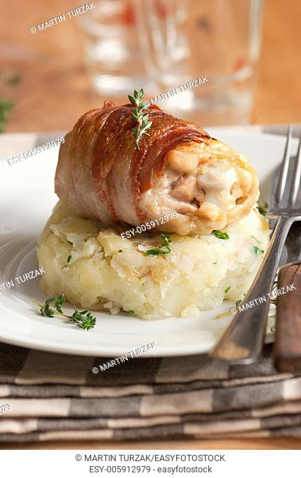 Chicken thighs wrapped in Pancetta with crushed new potatoes