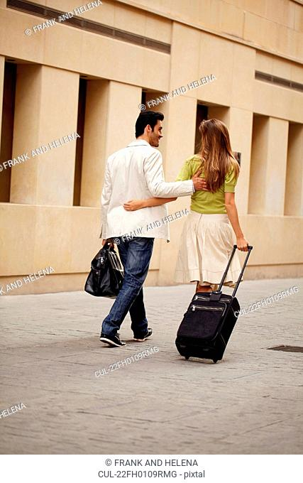 Couple walking with luggage