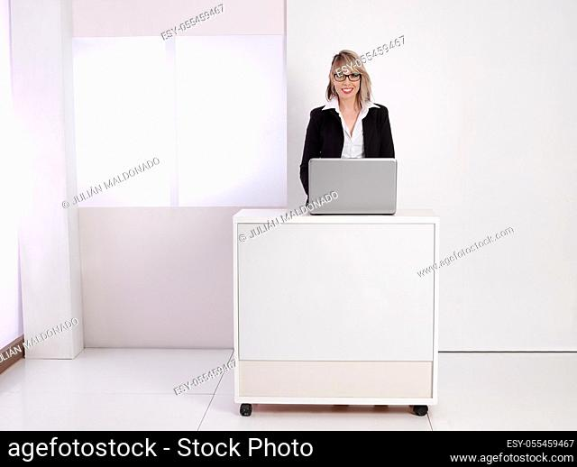 Young business woman at her desk