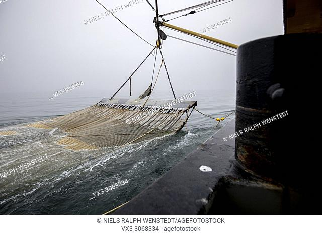 Fishermen working on a Dutch fishing boat. They are using the electric pulse fishing method. North Sea