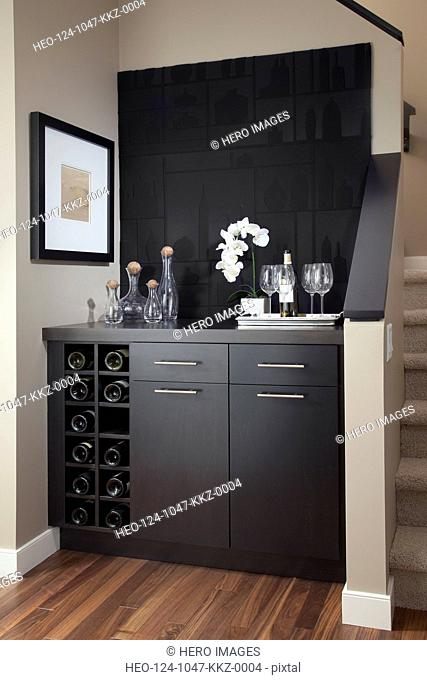 Cabinet with wine rack in contemporary house
