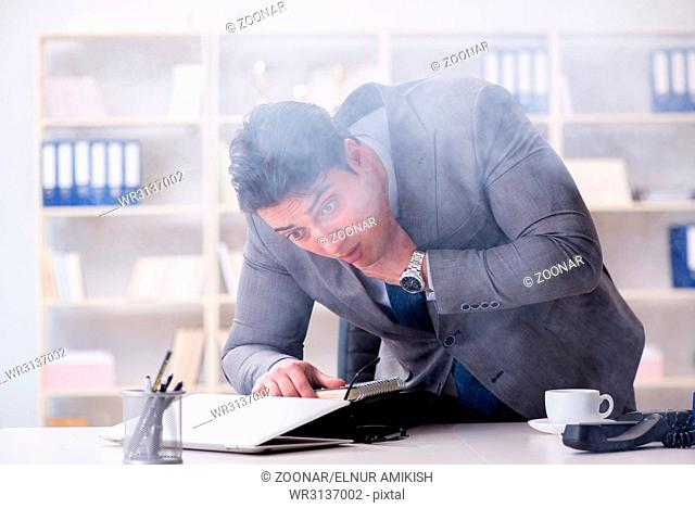 Businessman during fire alarm in office