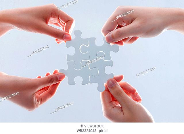 Holding a jigsaw puzzle