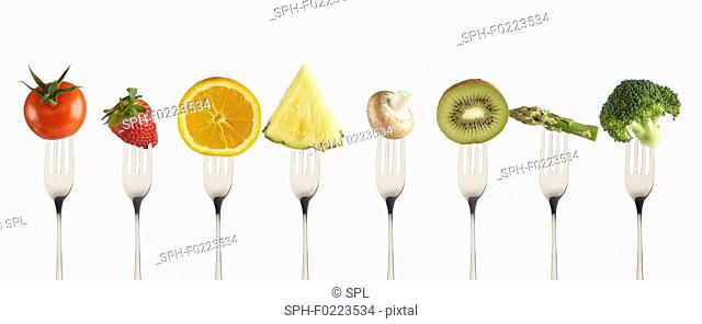 Fresh fruit and vegetables on forks