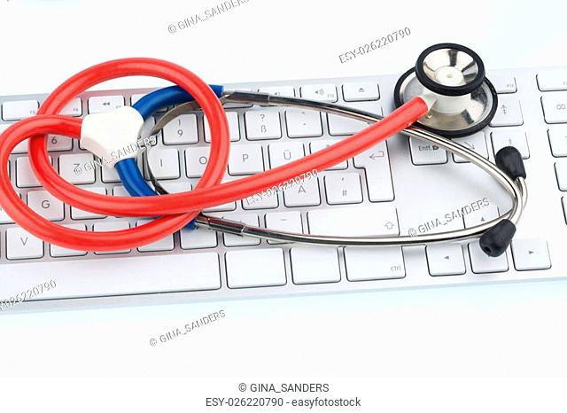 stethoscope and computer keyboard, symbol photo for doctor's appointments, and it management