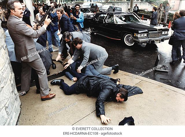 Seconds after the assassination attempt on the life of President Ronald Reagan. James Brady lies (light blue suit) wounded