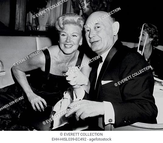 Boris Morros posing with Ginger Rogers at the Harwyn Club in NYC, Nov. 13, 1957. Morros, a Hollywood producer, was spied for the Soviets during World War 2