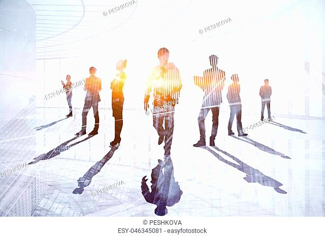 Teamwork, meeting and technology concept. Businesspeople crowd silhouettes on light city office background. Double exposure