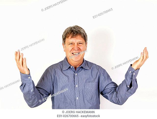 portrait of smiling happy casual dressed man in studio
