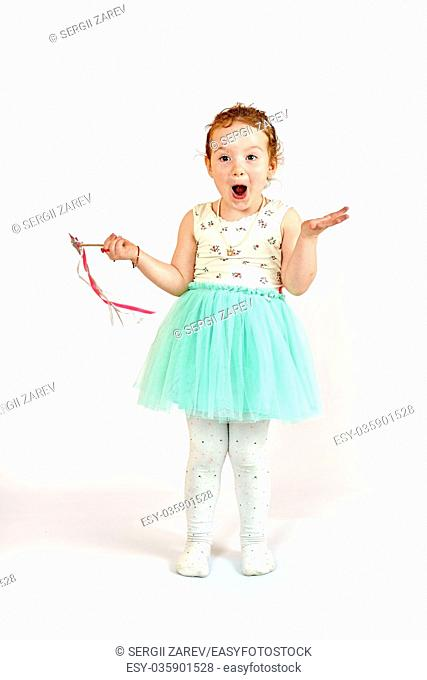 Fashion little girl in green dress, in catwalk model pose, stock photo. Image 02