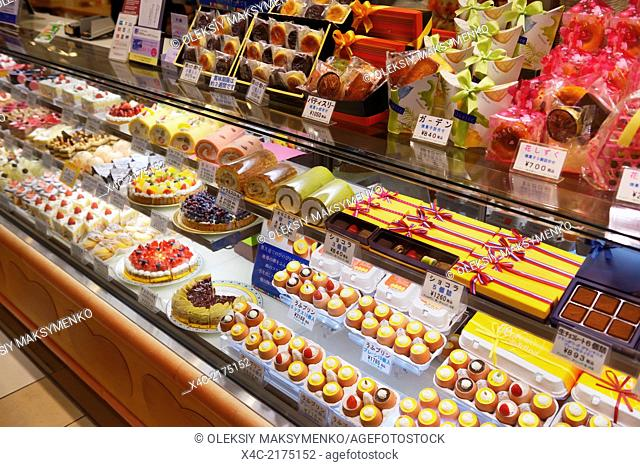 Cakes, rolls and pastries on a display at a Japanese bakery. Tokyo, Japan