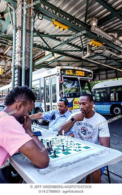 New York, New York City, NYC, Bronx, West Farms Square, East Tremont, bus stop, friends, Black, man, chess, game, board, playing