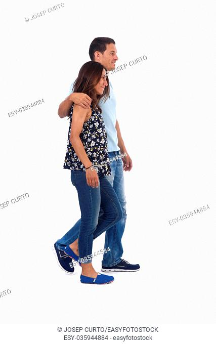 A couple of forty years walking on white background