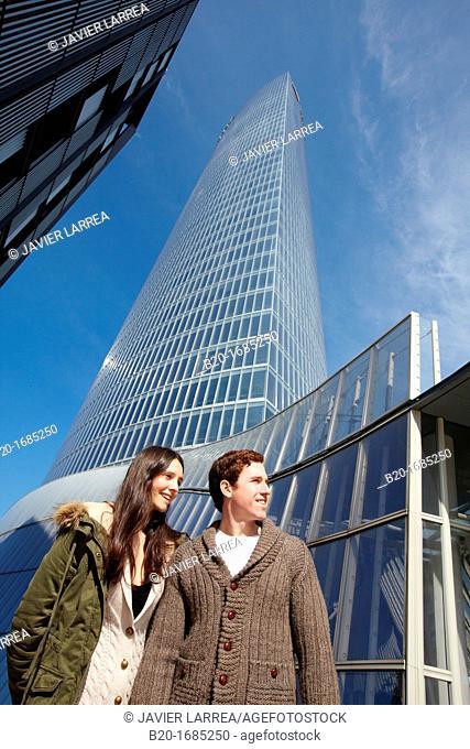 Young couple walking, Iberdrola Tower, Padre Arrupe Bridge, Abandoibarra, Bilbao, Bizkaia, Basque Country, Spain