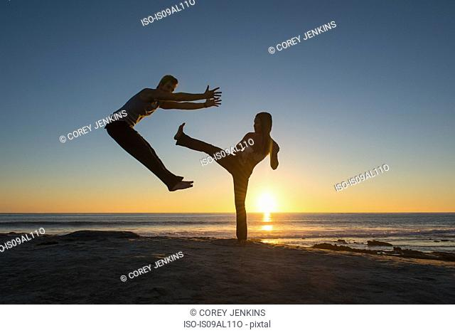 People in jumping and kicking poses on Windansea beach, La Jolla, California