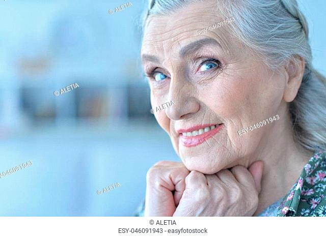 close up portrait of beautiful happy senior woman at home