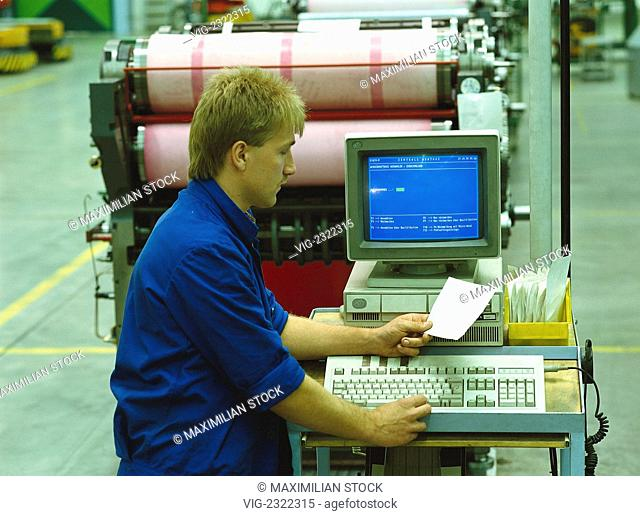 INDUSTRIAL MECHANIC ENTERING PRODUCTION DATA INTO A SHOPFLOOR TERMINAL. - 01/01/2010