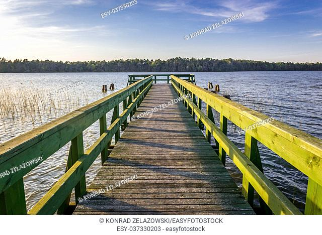 Viewing pier at Dolgie Wielke Lake in strict protection area of Slowinski National Park, located on the Baltic coast in Pomeranian Voivodeship of Poland