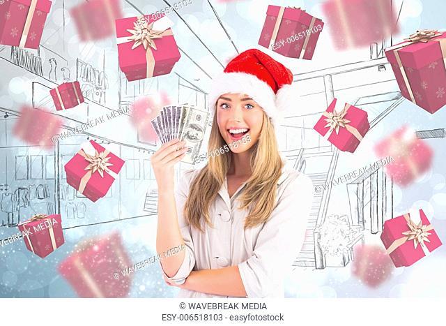 Composite image of festive blonde holding fan of dollars