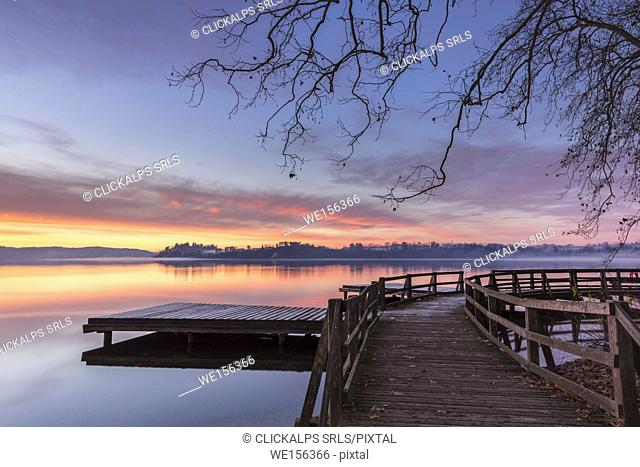 Winter sunrise on the Gavirate pier of Lago di Varese, Varese Province, Lombardy, Italy