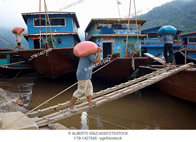 Loading and unloading in the river port Pakbeng, in the Mekong River in Laos