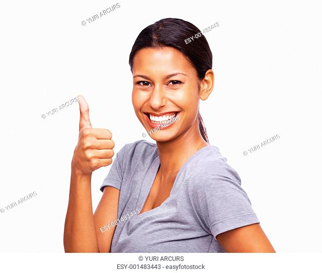 Cheerful young girl gesturing thumbs up sign over white background - Best luck