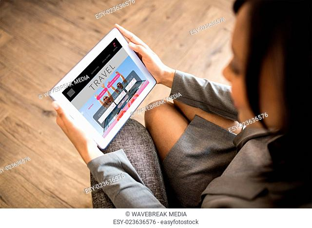 Composite image of businesswoman using tablet