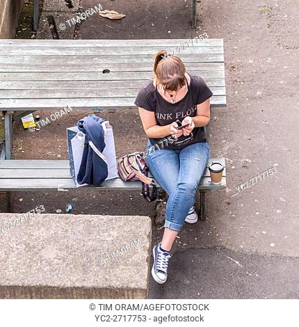 A girl on her mobile phone in the Uk