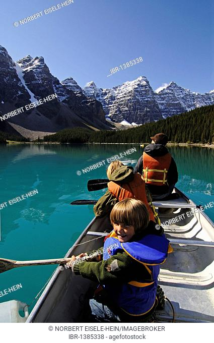Family in canoe, Moraine Lake, Banff National Park, Alberta, Canada