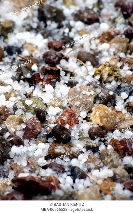 Photography of hailstones on a pebble subsoil