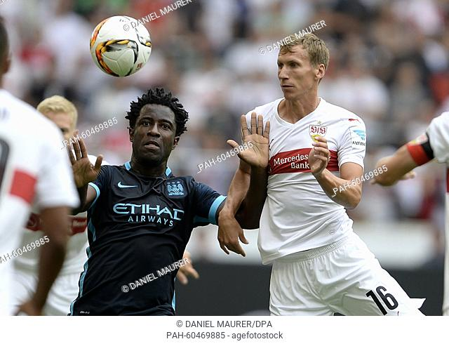 Stuttgart's Florian Klein (r) and Manchester's Wilfried Bony compete for the ball during the friendly match between VfB Stuttgart and Manchester City at the...