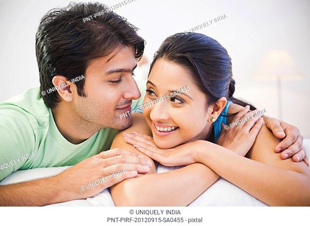 Romantic couple lying on the bed