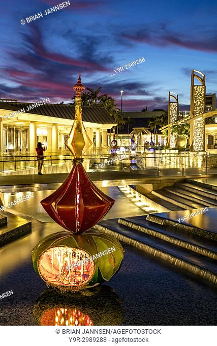 Christmas decorations and colorful sunset at the Waterside Shops - an upscale open-air mall, Naples, Florida