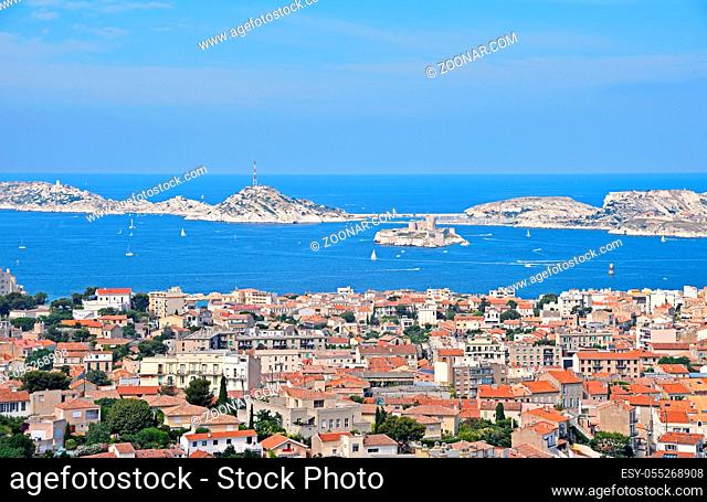 View of Marseille city, marina and port with the Chateau d?If, famous historical castle prison on island in Marseille bay, high angle view