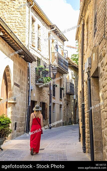 Tourist woman walking down street in Laguardia Rioja alavesa wine route. Alava. Basque country. Spain
