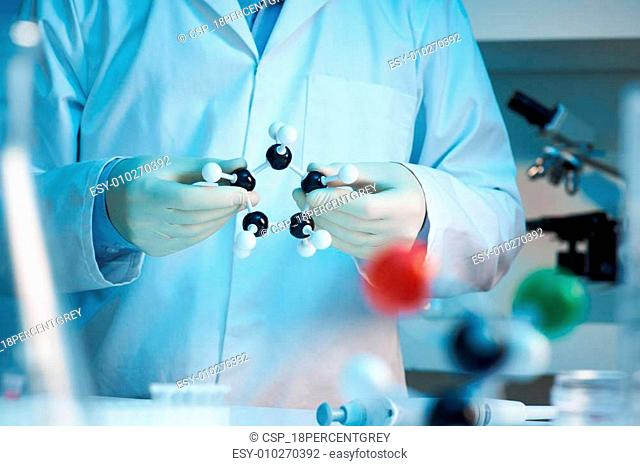 Scientist holding molecular model