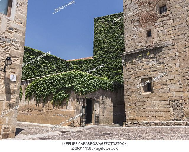 Caceres, Spain - july 13, 2018: House of the walls-Saavedra and tower of Sande, is Gothic, of the 14th century, rebuilt in the 15th century, square of San Mateo