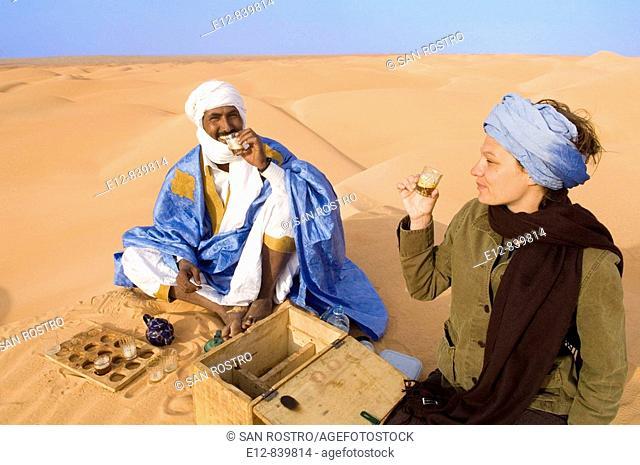 Drinking tea in the desert, Chinguetti. Adrar Plateau, Sahara Desert, Mauritania