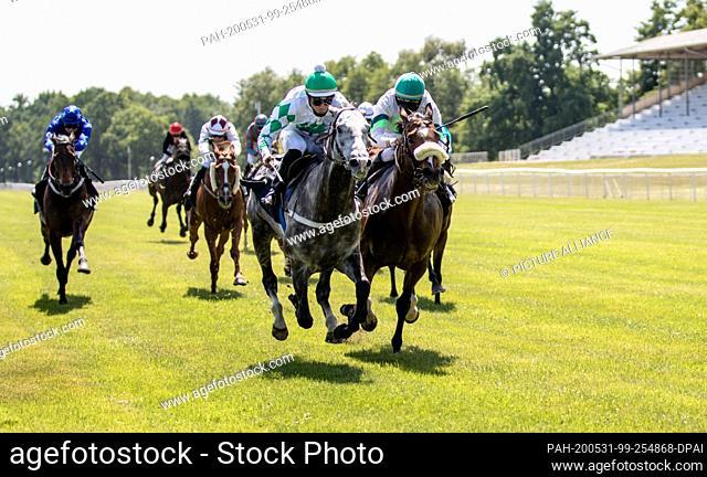 31 May 2020, Brandenburg;Berlin, Hoppegarten: Horse racing: Gallop, Hoppegarten Racetrack, second day of racing. Jockey Bauyrzhan Murzabayev wins on Zaro from...