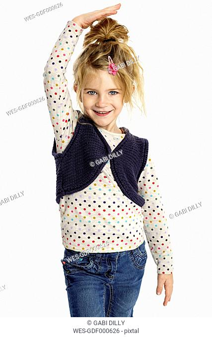 Blond little girl presenting her size in front of white background