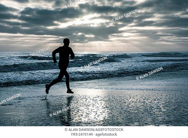 Saturday, 19th, April, 2014, The Headland, Hartlepool, England, United Kingdom. Jogger at sunrise on a frosty morning in north east England