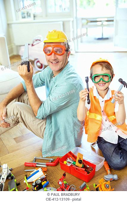 Father and son playing with construction toys