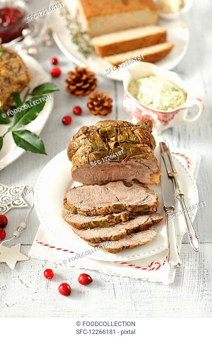 Beef roast with bay leaves and a herb and caper mayonnaise