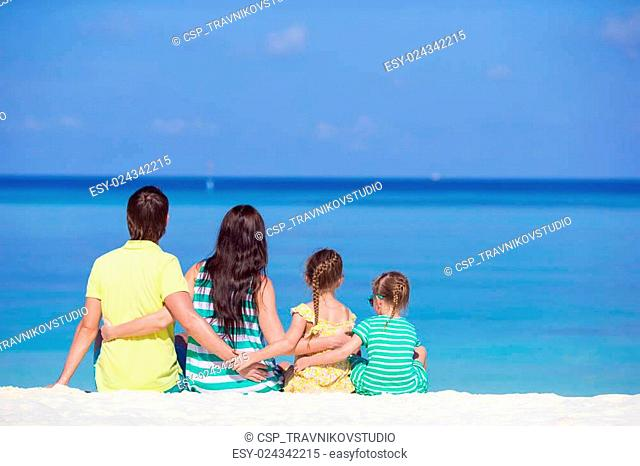 Happy family having fun on white beach