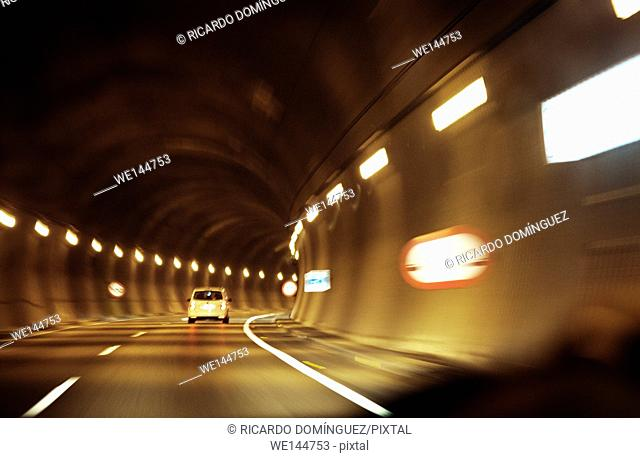 Fast car driving in a tunnel