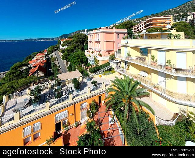 France, Cote Dazur, Beaulieu, 02 October 2019: Aerial view of French Riviera's terraces of expensive country houses and estates, palm trees, pools, stony coast