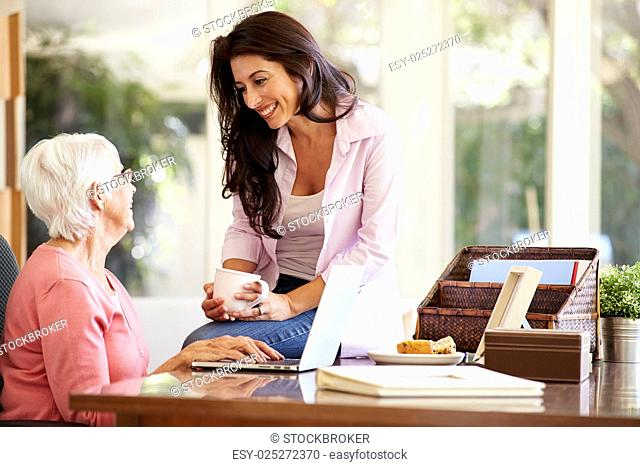 Adult Daughter Helping Mother With Laptop