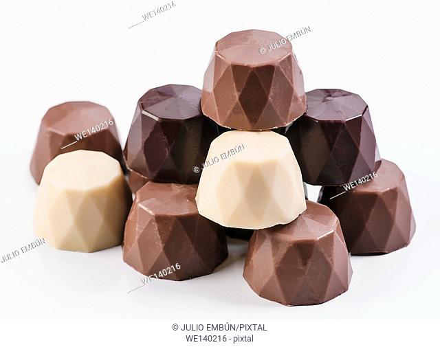chocolate bonbons on white base