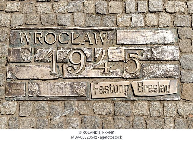 Poland, Wroclaw, remembering the Fortress Breslau in 1945. Nineteen bronze plaques telling about great events of the town history varnished in granit paving