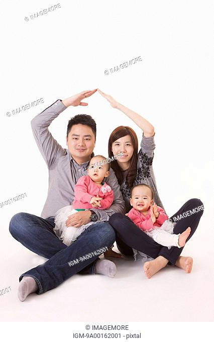 Young family with baby twins gesturing with smile